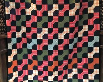 Antique orange, black and olive bowtie quilt