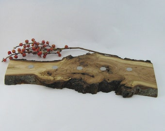 Rustic magnetized knife holder in cherry burl appr. 18 x 8 in. Item no: 155
