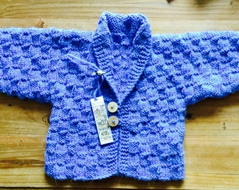 Boys or girls hand knitted cardigan/ jacket. Ages 6 to nine months or nine months to a year. Made to order in any color.