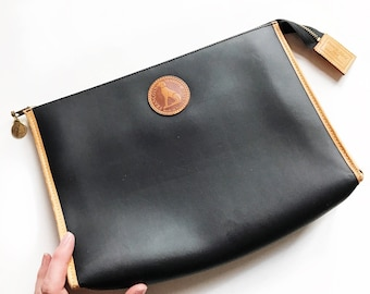 Black and brown vinyl and leather Francois Marot Paris clutch/toiletry bag.