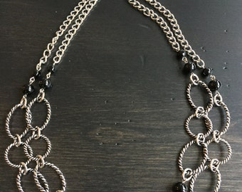 Convertible silver patterned links and black glass bead necklace.