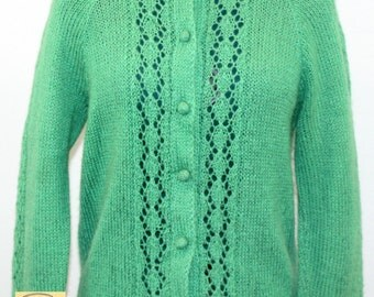 Bright Green Cardigan Sweater with loose knit front panels and down the sleeves. No brand label. Spring sweater, unique sweater, too sweet