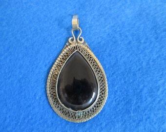 Black Brass colour pendant from Saudi Arabia