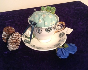 Gorgeous teacup pin cushion with blue/green insert