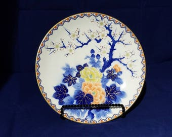 Beautiful vintage Japanese plate with a cherry blossoms design.