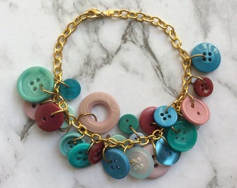 Button Charm Bracelet in Teal Aqua and Mauve with gold chain