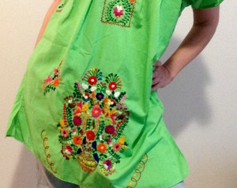 Bright green embroidered tunic