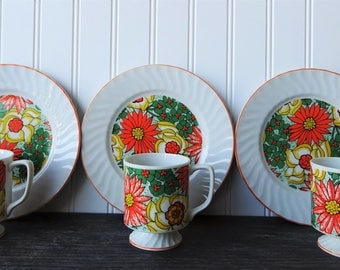 Set of 3 Retro Orange and Yellow Floral Stacking Mugs & Saucers