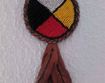 lBeaded Medicine Wheel on beige leather