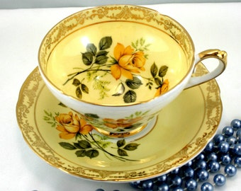 Royal Sutherland Teacup & Saucer, Orange Rose Pattern on Crisp Yellow Borders, Ncely Gilded Edges, Bone English China made in 1960s.