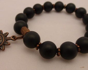 8mm Matte Black Onyx Beads with Copper Daisy Spacers // Antique Copper Smiley Sun Charm // Stretch Bracelet