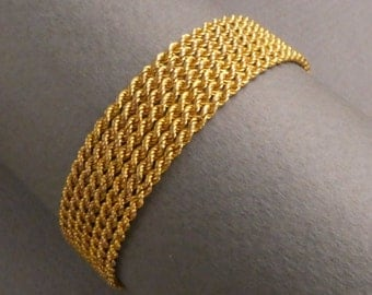 14K- 7 chain link bracelet