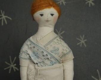 Entirely handmade cloth doll. Vintage, retro.