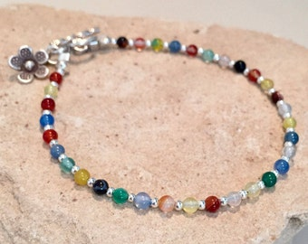 Multicolored bracelet made with agate beads, sterling silver round and triangle beads with a Hill Tribe silver toggle clasp and flower charm