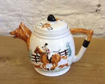 Vintage PPC pottery teapot with fox hunting scene. - Lovely design with riding crop handle and riding hat lid knob in good condition