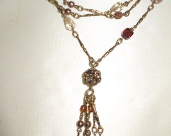 Lovely vintage goldtone long necklace with amber and clear glass beads