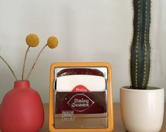 Vintage yellow metal Dairy Queen napkin dispenser