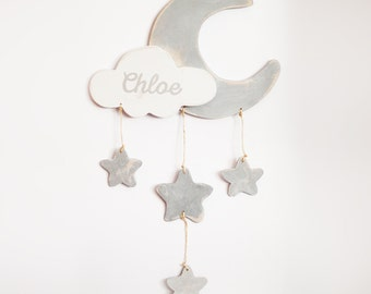 Mobile hanging from wooden model Luna. Wedge