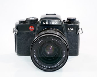 Legendary Leica R4 SLR Camera with Leica Vario-Elmar-R 35-70 f3.5 lens and some other options. MINT!!!