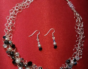 Crocheted necklace and earring set. Necklace black, white and grey glass pearls. Swarovski crystals.