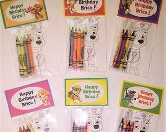 12 Sets of Personalized Paw Patrol Birthday Party Favor Bags with mini coloring pages and crayons