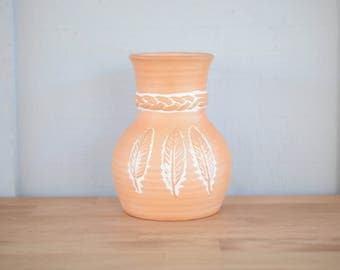 Southwest vase, feather, clay, terra-cotta, earthenware, boho