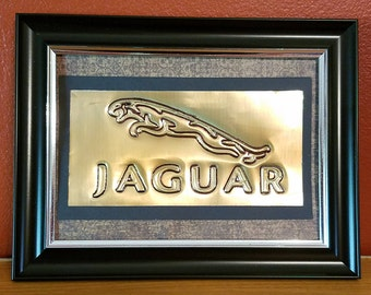 Handmade Embossed Jaguar logo made from a recycled soda can.