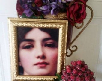Hanging Wall Art of Renaissance woman portrait.