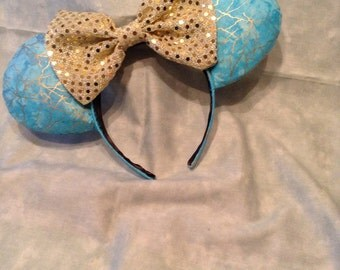 Stormy blue Mickey ears with gold sequin bow