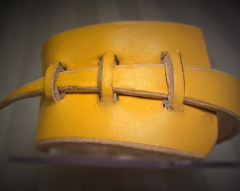Bangle bracelet, chunky leather, modern style.