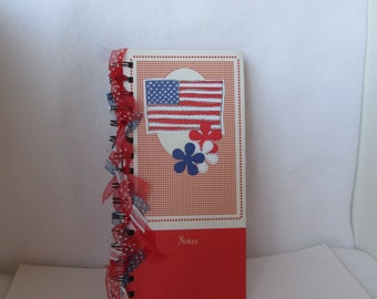 Decorative journal with lined pages.  Ribbon tied spiral notebook.  Red White Blue with flag.