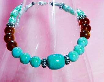 Unique aqua and dark amber tigerseye bracelet. This lovely bracelet is created in a classic style.