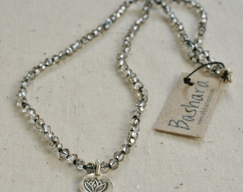 Hand knotted Necklace - crystal on silk with Thai silver lotus flower charm