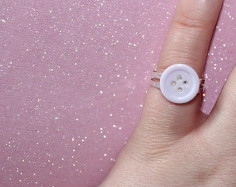 Cute as a button ring in pastel lilac