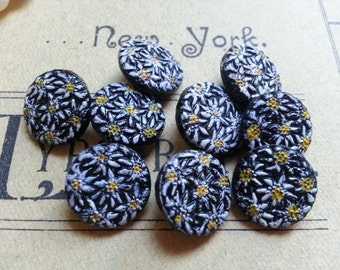 "NINE Small, Daisy Flowers on Black Glass Buttons. Vintage. Measure 1/2""."