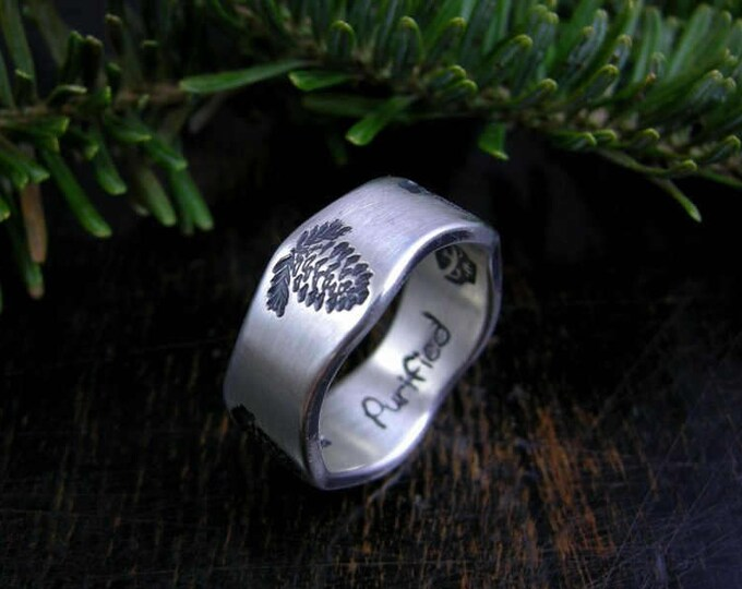 Made to order pine cone stamped band with brushed finish and dark patina
