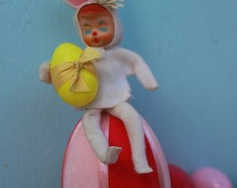 Vintage Style Pose Easter Doll / Pixie, White and Yellow,  Sitting on Pink Flocked Easter Egg