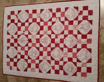 Baby red work quilt