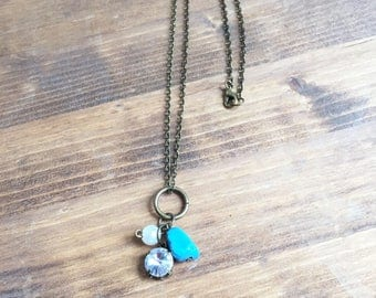 Long Upcycled Charm Necklace: Turquoise, Pearl, and Rhinestone Accents