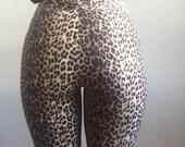 cheetah print cigarette pants 90s vintage pocketless high waist boot cut CLUB KID hip hop hipster rocker leopard bottoms 7 8 9 stretch fun