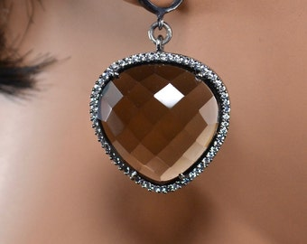 LP 1381  Faceted ,Heart Shaped Brown Quartz In A Black Gold Bezel, With White CZ's