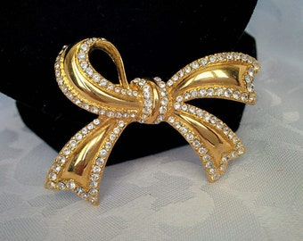 Monet Gold Tone and Crystal Bow Brooch