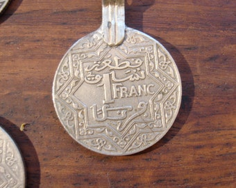 Moroccan tarnished  1 franc coin with metal bail or loop