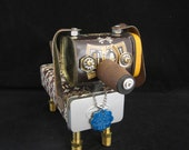 Fossil Dox Bot - found object robot sculpture assemblage by Cheri Kudja with Bitti Bots