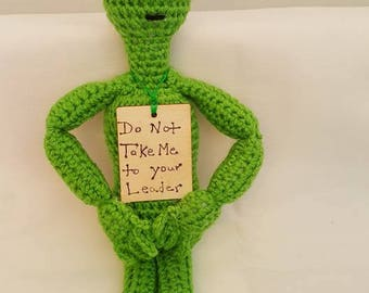 "Amigurumi Crochet Alien doll,collectible, conversation piece,  with sign ""Do not take me to your leader"""