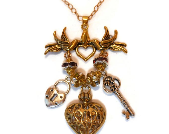 FREE SHIPPING Love charm necklace, pendant dove holder with heart, lock and key Swarovski rounds balls, gold plated chain, charms not plated