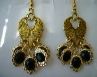 Gold Tone Chandelier Earrings with Gold Tone and Black Charm Dangles