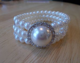 3 Row White Sea Shell Pearl Stretch Cuff Bracelet with a White Pearl and Clear Rhinestone Medallion