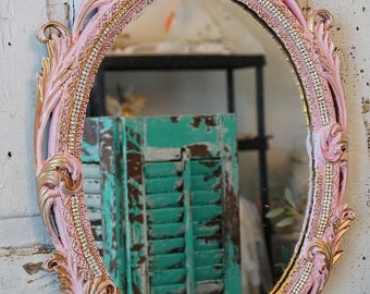 Ornate framed mirror wall hanging pink gold and rhinestone trim shabby cottage chic vintage heavy embellished frame decor anita spero design
