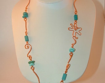 Copper and Blue Bead necklace- Copper flower necklace- Flower clasp necklace- Copper wire and blue beads necklace